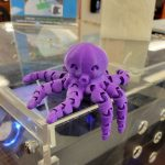 3D printed purple Octopus sitting on one of the Kalamazoo College 3D printers.